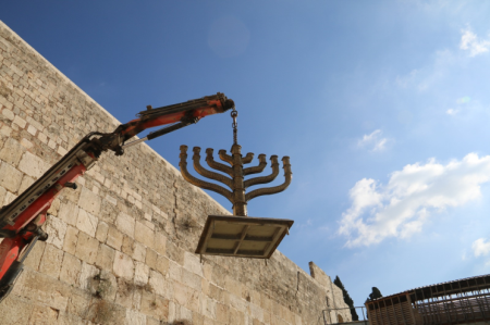 Putting up the menorah in the Western Wall Plaza