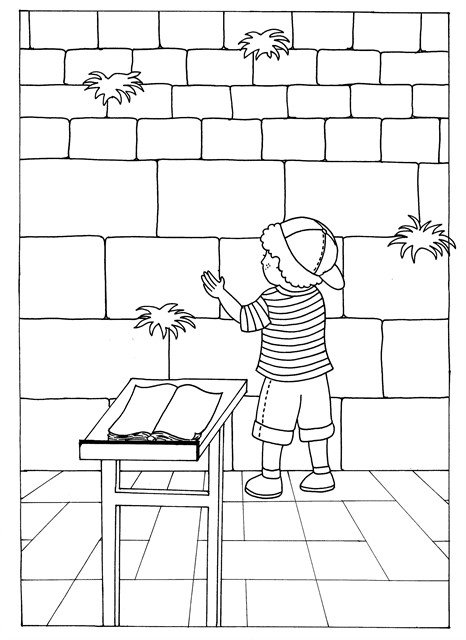 A child prays at the Western Wall